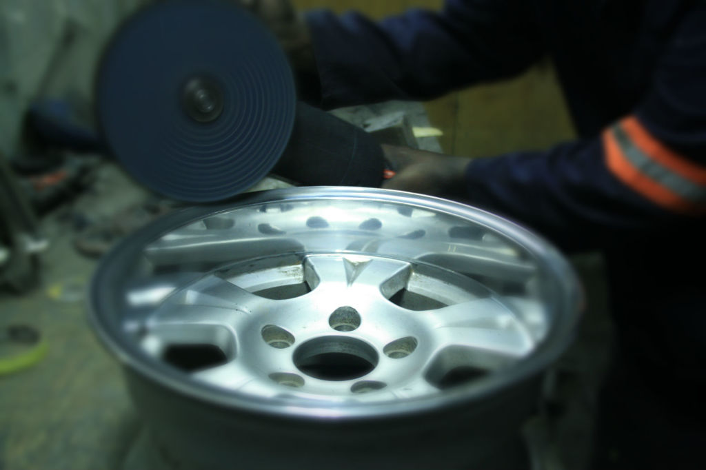 A rim being polished at Holland Metal Products